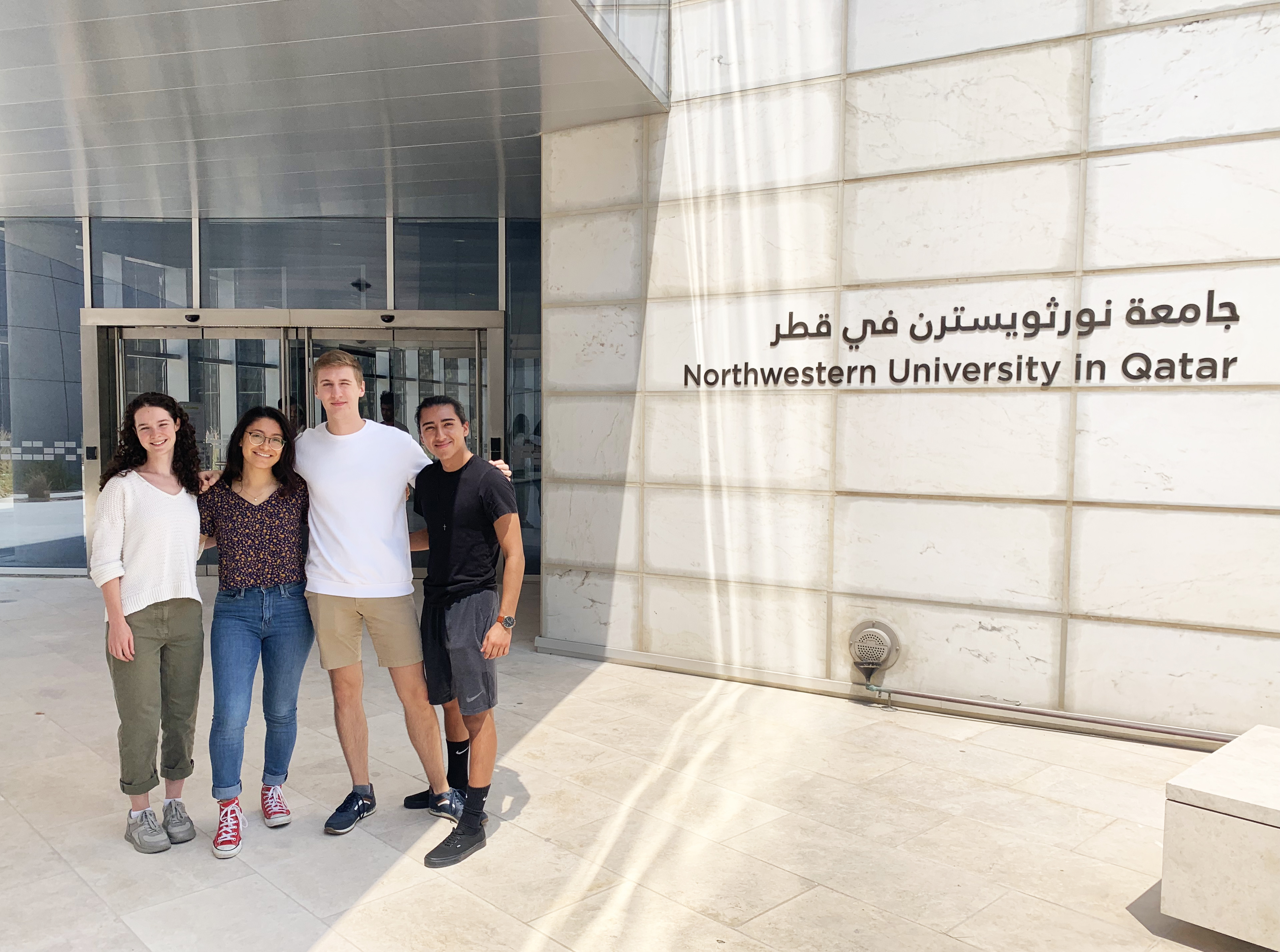 A group of four students from Evanston -- (l to r) Eliza Posner, Leslie Bonilla, Martin Herrmann, and Miguel Aponte -- are spending 16 weeks on Northwestern's Qatar campus to learn about and immerse themselves in the values and vibrancy of the Middle East.