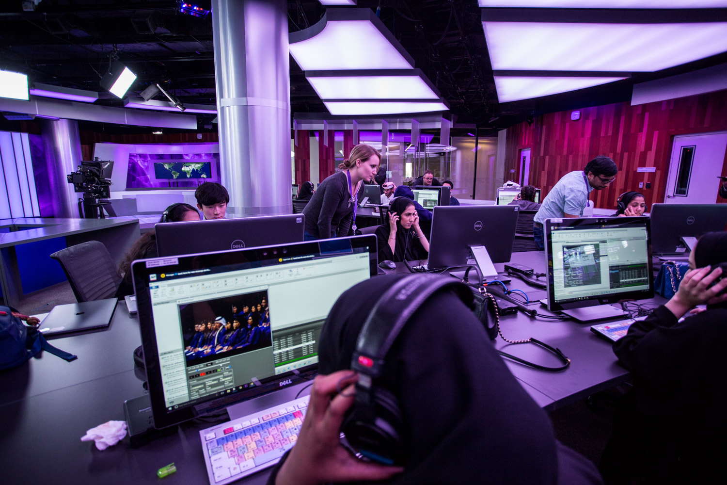 Designed by Beirut architect Ali Wazani, the space allows students to work in all components of news production. Using a feed from live newswires, students are able to gather information and transform it into stories, graphics, and other digital visualization elements. The automated newsroom, which is the first of its kind in Qatar, and unique in the region, enables one person to run the entire show.