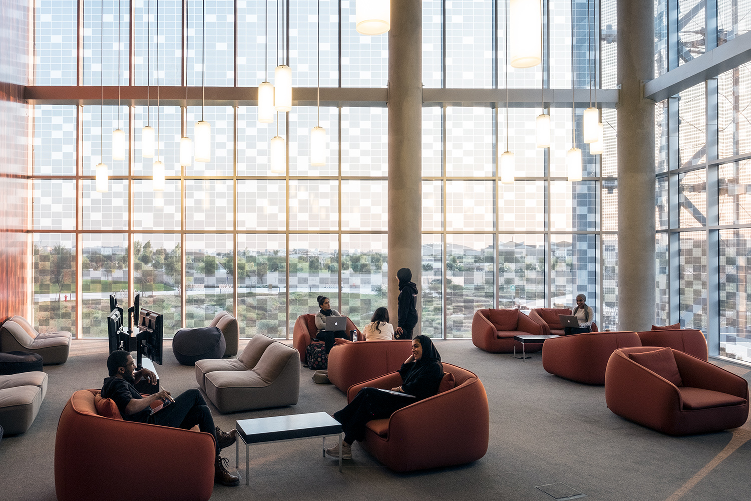Located in the heart of NU-Q's building is a two-story library overlooking the Education City Oxygen Park.